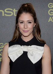 Amanda Crew styled her hair in a half up half down look.
