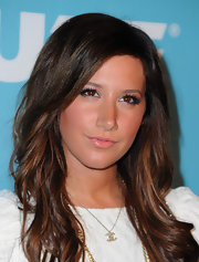 Ashley Tisdale added a little flair to her wink with defined lashes. Sparkling gloss and bronzed skin completed her look.