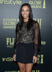 Corinne Fox styled her hair in a sleek straight cut for a polished look.