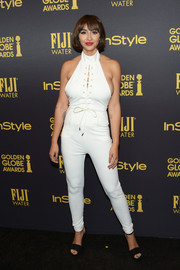 Jackie Cruz showed some side cleavage in this white halterneck jumpsuit that the actress styled with Chinese Laundry Avenue Platform sandals in black at the HFPA and InStyle Golden Globe Award season celebration.