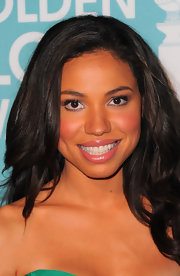Jurnee added a soft touch to her look with a glossy pink lip.