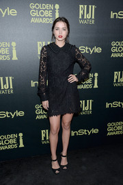 Ana de Armas wore an above-the-knee black lace dress with a beaded collar and long-sleeves for a chic appearance.