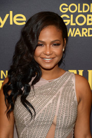 Christina Milian attended the HFPA and InStyle Golden Globe Award season celebration wearing glamorous side-swept curls.