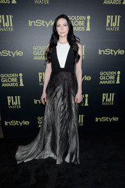 Laura Prepon wore a black and white printed dress that had a floor-skimming train and color-blocking bodice.