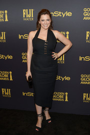Rachel Bloom went modern in an asymmetrical black halter dress for the HFPA and InStyle Golden Globe Award season celebration.