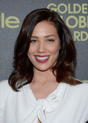 Michaela Conlin styled her hair in a side-parted layered cut