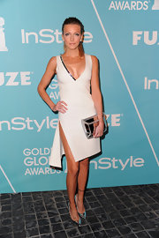 Katie Cassidy matched the sequin embellishments on her white dress to her silver pumps. The pointy toe metallic heels were a sexy and futuristic choice for the actress.