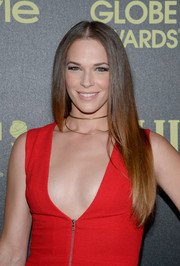Amanda Righetti styled her hair in a sleek straight cut with layered textures