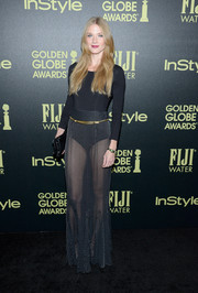Winter Ave Zoli donned a long-sleeved bodysuit to complement her look
