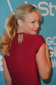 Charlotte Ross pulled her long locks back in a sleek ponytail complete with soft curls.