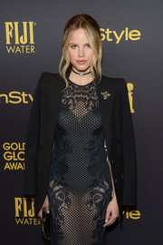 Halston Sage tempered her sexy sheer frock with a black blazer when she attended the HFPA and InStyle Golden Globe Award season celebration.