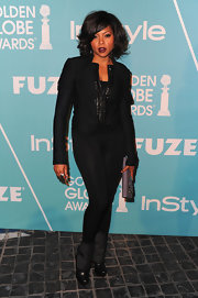 Taraji P. Henson rocked unique Louboutin boots folded over and buckled. The heels gave her sleek monochromatic look a funky vibe.