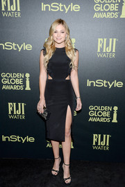 Olivia Holt wore a black cut-out dress with a thigh-high slit for an alluring look.