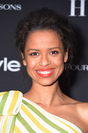 Gugu Mbatha-Raw paired a bright orange lip with her citrus-hued outfit for a totally vibrant look.