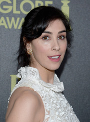 Sarah Silverman styled her hair in a messy updo with side-swept bangs for a chic look.