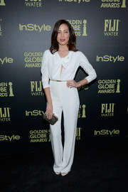 Michaela Conlin donned a white long-sleeved jumpsuit with a pussybow tie for a chic outfit