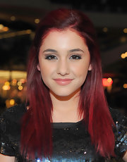 Ariana pulled her vivid red tresses back in a half up hairstyle.