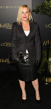 Patricia wears a sophisticated blazer over a matching vest and leather skirt for the Hollywood Reporter Big 10 Party.