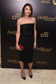 Bethenny Frankel's studded red clutch and black dress were a very stylish pairing.