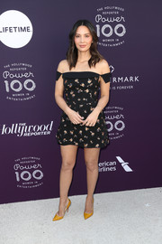Olivia Munn injected a bright spot with a pair of mustard pumps by Christian Louboutin.