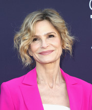 Kyra Sedgwick wore a messy wavy updo that was equal parts edgy and sweet when she attended the Hollywood Reporter's 2017 Women in Entertainment Breakfast.