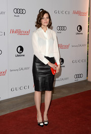 Mandy Moore continued the black, white, and orange theme with a pair of Jimmy Choo Lekker pumps.