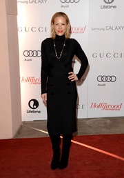 Maria Bello was winter-chic in a black suspender skirt worn with a turtleneck during the Women in Entertainment Breakfast.