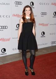 Alyson Hannigan contrasted her adorable dress with edgy-chic leopard-print peep-toe boots by Christian Louboutin.
