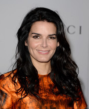 Angie Harmon wore her hair down with mussed-up curls when she attended the Women in Entertainment Breakfast.