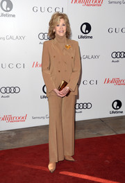 Jane Fonda channeled the '70s with this tan pantsuit worn with a turtleneck at the Women in Entertainment Breakfast.