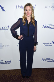 Julia Stiles matched her top with a pair of blue slacks.