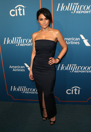 Emmanuelle Chriqui was all about simple sophistication in a strapless black column dress by Camilla and Marc at the Hollywood Reporter 5th Annual Nominees Night.