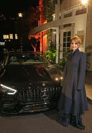 Marina de Tavira arrived for the Hollywood Reporter Oscar nominees party wearing a navy military coat.