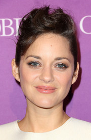 Marion Cotillard rocked a messy pompadour at the Hollywood Reporter's Oscar nominees party.