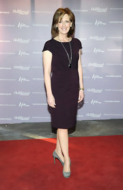 Ann Sweeney accessorized her classic dress with gray platform pumps.