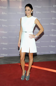 Bethany Frankel looked phenom at the 'Women in Entertainment Breakfast' wearing a textured sheath dress with thigh slits.