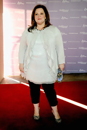 Funny gal Melissa McCarthy donned a frothy ruffled cardigan over a shimmery tunic at the Women in Entertainment breakfast.