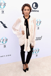 Kat Graham balanced out her baggy top with black skinny pants.