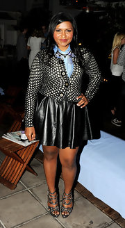 Mindy Kaling stayed sleek in her gray strappy heels that added a touch of shine and style to an already trendy outfit.