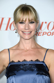 Meredith Monroe kept it casual with a ponytail and choppy bangs when she attended the Hollywood Reporter Emmy party.