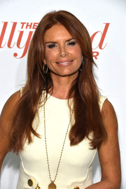 Roma Downey wore her long locks in a center part with subtle waves when she attended the Hollywood Reporter Emmy party.