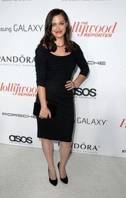 Christine Woods completed her elegant ensemble with a pair of emerald-green pumps and a clutch.