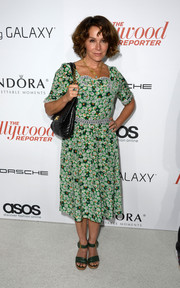 Jennifer Grey attended the Hollywood Reporter Emmy party wearing a busy-looking print dress.