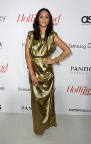 Cara Santana looked divine in a metallic gold evening dress at the Hollywood Reporter Emmy party.