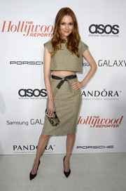 Darby Stanchfield bared a bit of belly at the Hollywood Reporter Emmy party in a beige crop-top and a matching skirt.