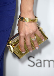 Brittany Ishibashi added sparkle to her ensemble with this metallic gold clutch when she attended the Hollywood Reporter Emmy party.