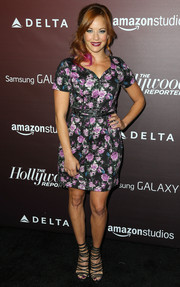 Amy Paffrath looked sweet and youthful in a floral mini dress during the Next Gen 20th anniversary gala.