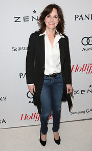 Sally Field look like the girl next door in skinny jeans and a white button-down top.