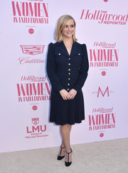 Reese Witherspoon completed her look with black T-strap pumps by Jimmy Choo.
