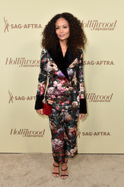 Thandie Newton styled her suit with strappy burgundy velvet sandals.